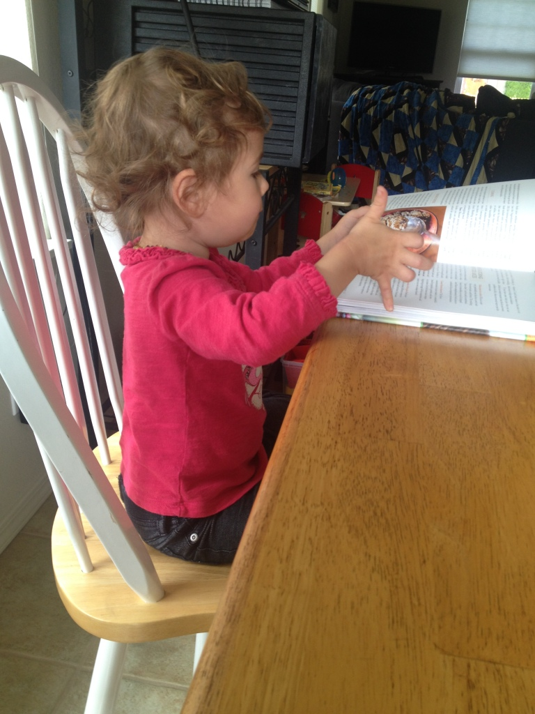 Our little herbivore thumbing through the Superfood Juices book!
